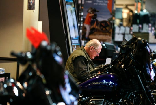Dick Behrens (cq) works in the Suburban Harley-Davidson on Wednesday, April 8, 2020 in Thiensville, Wisconsin. Behrens is a salesperson for the shop and only comes for appointments now. Behrens said he still had appointment almost everyday. Zhihan Huang/Milwaukee Journal Sentinel