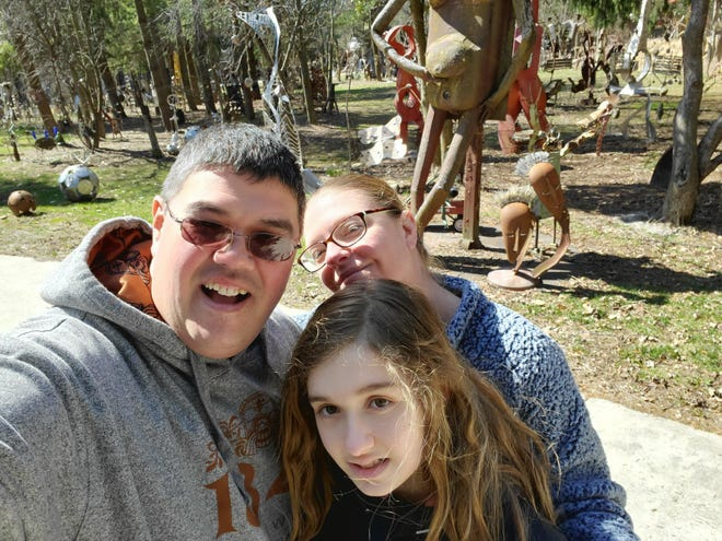 Bill and Erica Robarge and their daughter, Susie, who has autism, have faced challenges in conducting virtual learning without the normal support staff that Susie would normally have.