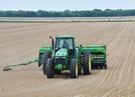 A farmer plants soybeans in a field in Acadia Parish. Farmers are expected to plant approximately 900,000 acres of soybeans across Louisiana in 2020. Dry conditions in the southern part of the state are slowing down planting, while wet conditions in the north Louisiana are keeping farmers from getting into their fields.