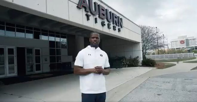 Auburn linebackers coach Travis Williams shoots a recruiting video outside the athletics complex in March.