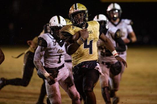 Lanett's Kristian Story (4) rushes for a touchdown in the first half. Lanett vs Elba on Friday, Nov. 15 in Lanett, Ala.