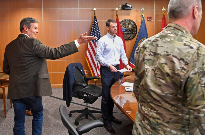 Gov. Bill Lee waves to members as he arrives to attend the Unified Command briefing at the Department of Military complex on Sidco Drive in Nashville, Tenn. Monday, April 6, 2020.