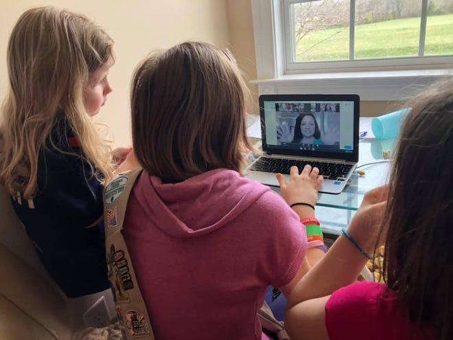 Members of Girl Scout Troop 182 participate in a virtual troop meeting.