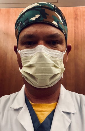 Dr. Jason Martin, 43, is a pulmonary and critical care specialist at Sumner Regional Medical Center now working on the COVID unit.