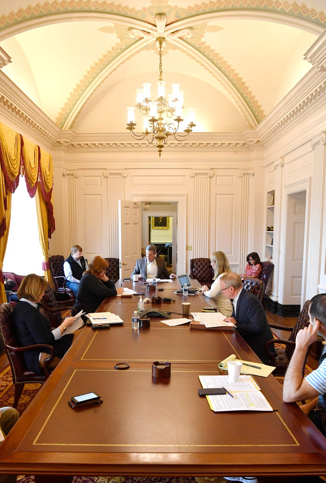 Gov. Bill Lee attends a meeting with senior staff in his conference room at the Capitol in Nashville, Tenn. Monday, April 6, 2020.