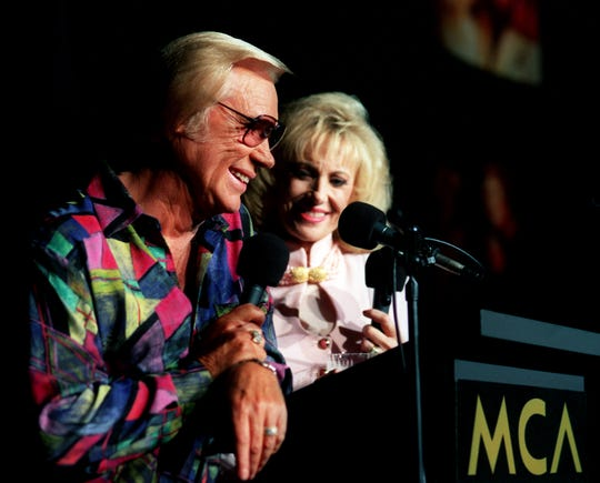 George Jones, left, and Tammy Wynette announce their new MCA album and companying tour together at Scene Three in Nashville April 18, 1995.