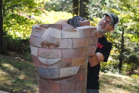 James Tyler, an artist from Haverstraw, New York, installs his sculpture, titled 'Iyemoja,' at Laurelwood Arboretum in Wayne in October.