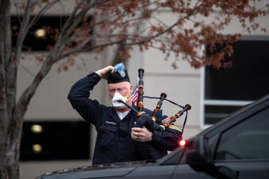 A bagpipe player waits for Dr. Jim Pruden to be discharged from St. Joseph's University Medical Center in Paterson on Wednesday, April 8, 2020. Pruden, a doctor at St Joseph's University Medical Center, was in critical condition with coronavirus.