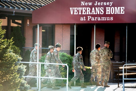 National Guard reservists arrive to the New Jersey Veterans' Home on Veterans Way in Paramus on April 8.