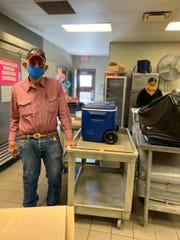 Employees wear protective masks to prevent the spread of coronavirus, April 3, 2020 at the San Jose Senior Center in Carlsbad.