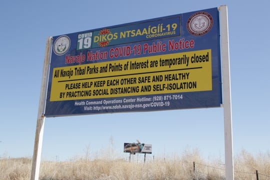 A sign notifying the public about the temporary closure of parks and points of interest managed by the Navajo Parks and Recreation Department is pictured on April 7 on Navajo Route 36 near Ojo Amarillo.