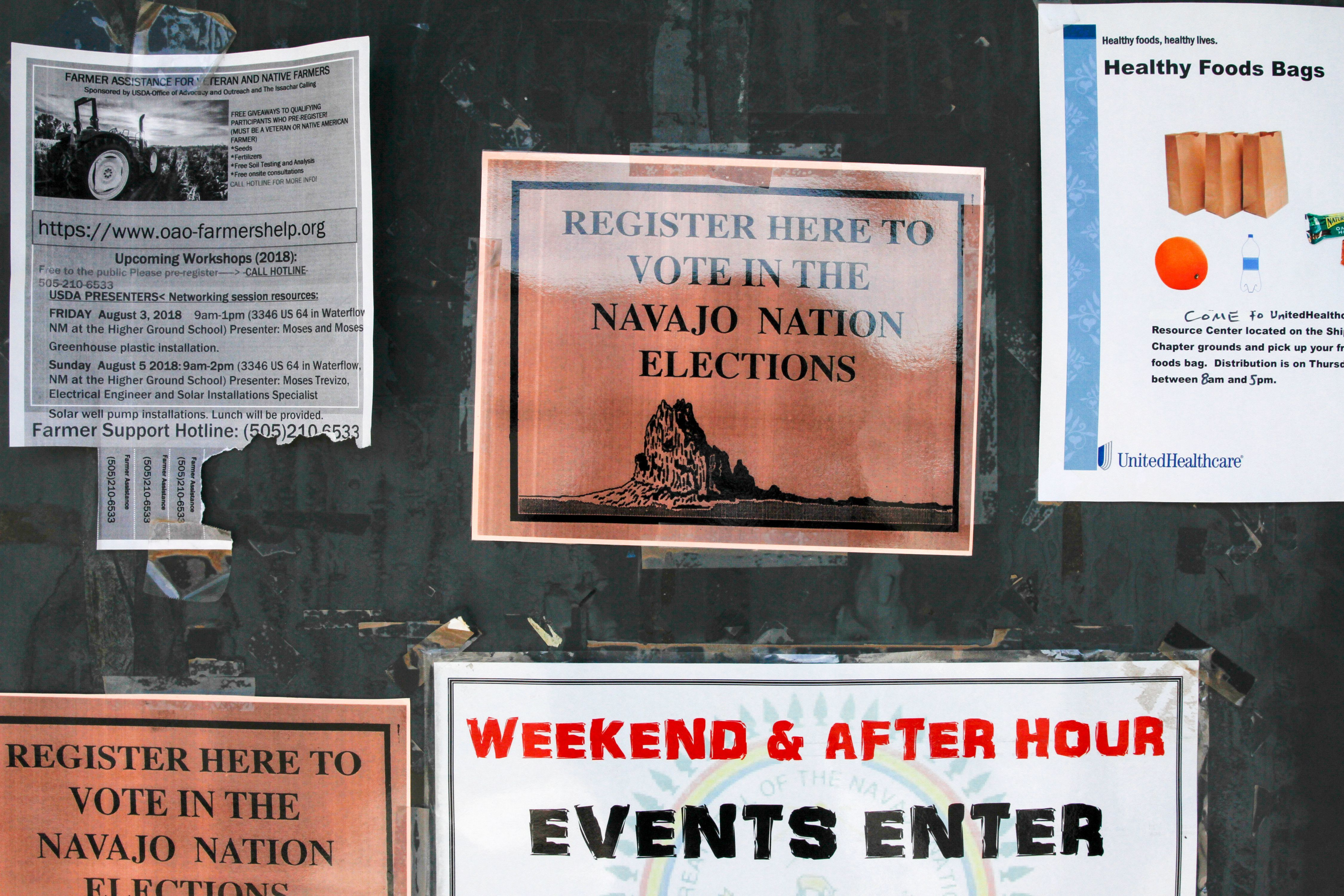 Voter registration signs are pictured on Aug. 25, 2018 at the Shiprock Chapter house.