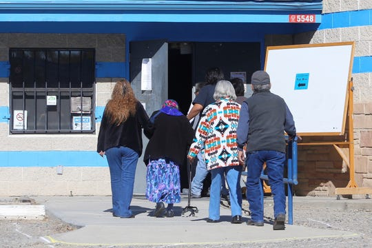 Voters enter the Shiprock Chapter house to cast ballots in the Navajo Nation general election on Nov. 6, 2018.