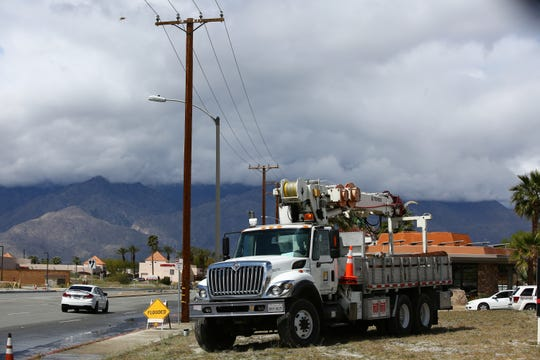A Southern California Edison truck is shown in the area where a vehicle hydroplaned into a utility pole on Ramon Road near Victor Road in Cathedral City on April 8, 2020.