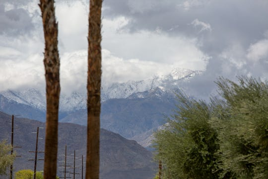 Snow blankets the mountains in this photo taken from Country Club Drive in Palm Desert, Calif., on Wednesday, April 8, 2020.