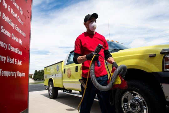 Neal O'Brien carries a fogging machine filled with a disinfectant called Biosque. Hanover-based 1-800-BoardUp of Southcentral Pa provided their free disinfectant service for more than 80 emergency vehicles from several local fire companies last weekend.
