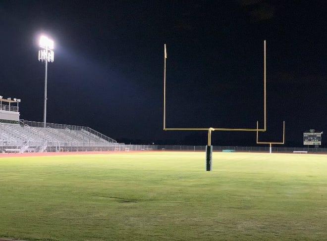 Basha High School's football field lights honor students.
