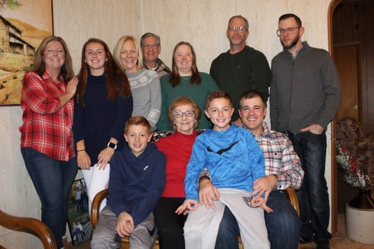 Mae Buch, center, sitting, wasn't able to be as close to her family as she is in this photo to celebrate her 87th birthday on Tuesday. But the family still found a way to make her big day a special one.