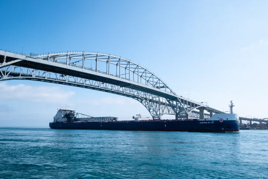 The 740-foot Algoma Sault passes under the Blue Water Bridge while traveling downbound on the St. Clair River Wednesday, April 8, 2020, in Port Huron.