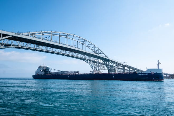 A Canadian woman possessing drugs was arrested on the Blue Water Bridge Monday night after she took a wrong turn following her GPS.