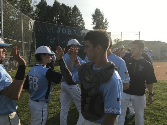 John Jay-East Fishkill High School baseball players celebrate a 13-1 win over Arlington last year. The team is fundraising this year for medical workers in the area amid the coronavirus pandemic.
