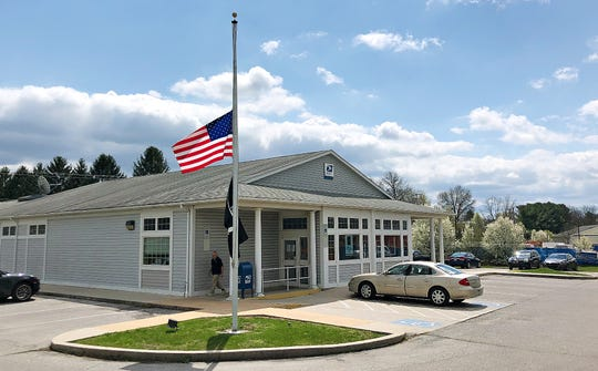 Flags are flown at half staff at the United States Postal Service in Shrewsbury, Wednesday, April 8, 2020. Dawn J. Sagert photo