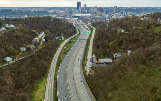 A stay-at-home order in response to the new coronavirus has meant little traffic on Pittsburgh's busiest streets, as seen with this sparse assortment of cars on the Parkway North during rush hour on Tuesday, April 7, 2020, in Pittsburgh. (Andrew Rush/Pittsburgh Post-Gazette via AP)