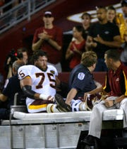Washington Redskins' Brandon Noble is carried off the field after injuring his leg during the first quarter against the New England Patriots in a preseason game Saturday, Aug. 16, 2003, in Landover, Md. (AP Photo/Lawrence Jackson)