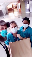 Former Penn State defensive lineman Brandon Noble has been delivering donated meals to healthcare workers during COVID-19 pandemic. He poses here with nurses from the Einstein Medical Center in Montgomery County.