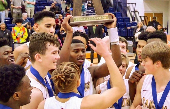 Jaden Bradley, center, and his Cannon teammates celebrate after winning the state championship for Class 4A Independent Schools in North Carolina in February. Bradley scored 27 points in that game and was the Gatorade player of the year in North Carolina as a sophomore.