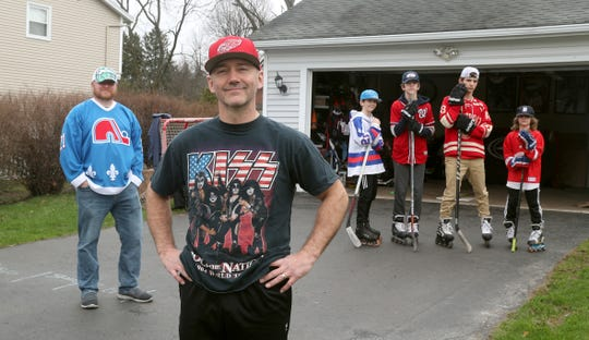 Dave Maksymiu with his sons, Wesley,11, Mason,13, Kelly,15, and Miles, 10, and YouTube video partner, RJ Henrichs offer online hockey training videos that can be done while still practicing social distancing.