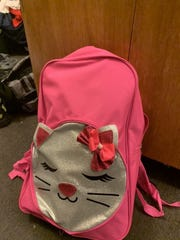 This pink backpack was worn by the last Simpson pitcher to give up a home run.