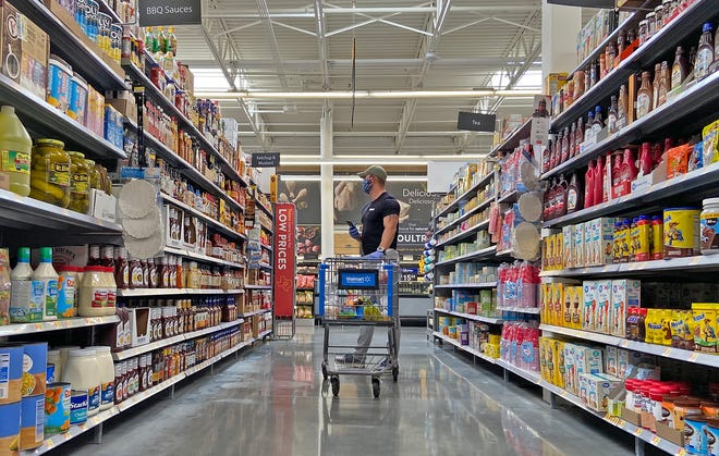 Matt Cutrer shops for a client at a local grocery store Wednesday, April 8, 2020.
