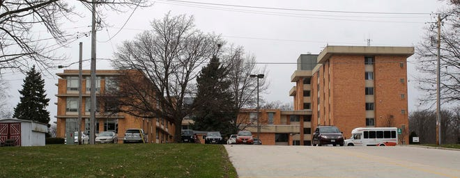 Sunny Ridge nursing home on the left, is connected by a wall with Taylor Drive apartments, right, as seen, Wednesday, April 8, 2020, in Sheboygan, Wis.