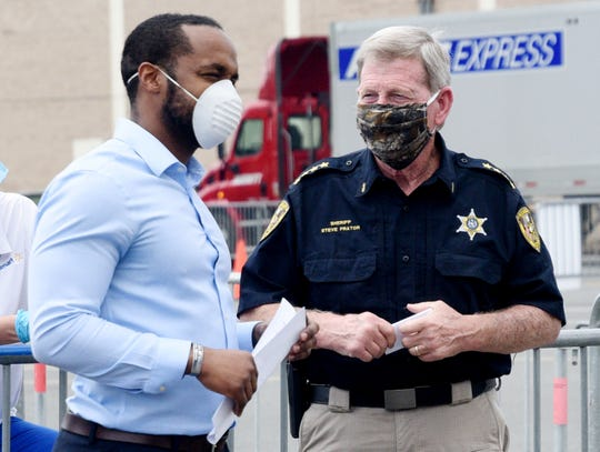 Shreveport Mayor Adrian Perkins speaks to Sheriff Steve Prator during the press conference at the new coronavirus testing site Wednesday afternoon in the Walmart parking lot at the Shreveport Barksdale Hwy, location, April 8, 2020.
