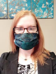 Felicia Kay, a mental health program manager, wearing a filtered fabric mask made by a friend, who also made enough for her staff to wear during the coronavirus pandemic.