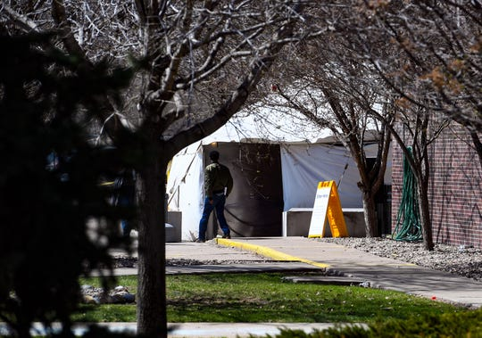 A Smithfield Foods, Inc. employee enters the building through a tent to be screened for symptoms of the coronavirus before being allowed inside on Wednesday, April 8, at the food processing plant in Sioux Falls.