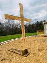 A cross built by Deke and Caeden Aleshire sits in the backyard of the family's Crimora home. They will use it to celebrate a family Easter service since they can't attend church during the COVID-19 health crisis.