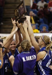 The Albany girls basketball team celebrates after beating Jordan 62-52 to win the state title in 2008 at Target Center.