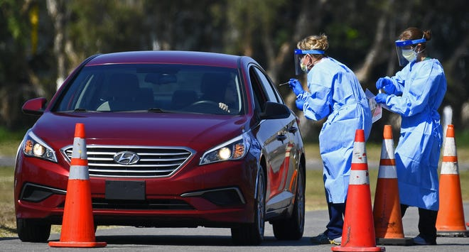 A patient is tested at Sarasota County's drive-thru coronavirus testing site at Sarasota's TwinLakes Park in March.