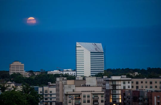 The super pink moon rises over Tallahassee on April 7, 2020. The moon is the closest and brightest it will be this year. The theme for this year's 50th anniversary of Earth Day on April 22 is to look after ourselves and our environment.
