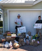 John Carroll Catholic football players Bryce Shevak (left) and Austin Shevak collected 681 pounds of food during the annual food drive this past weekend.