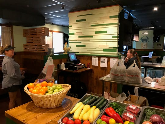 Market items for sale in The Green Marlin Restaurant and Raw Bar at 1475 US Highway 1, just outside Vero Beach. Left, customer, Dee Brown. Right, employee Kristina Taylor.