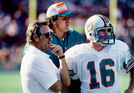 Miami Dolphins head coach Don Shula talks with quarterback David Woodley (16) on the sideline during a game Dec. 5, 1982, against the Minnesota Vikings at the Orange Bowl.