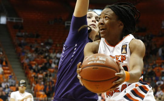 3. UTEP 79, TCU 71, March 24, 2016  UTEP guard Jenzel Nash looks up to the basket as she prepares to put up a shot against an unidentified TCU player during action in the third round game of the WNIT. The Mi ners walked away with a win 79-71.