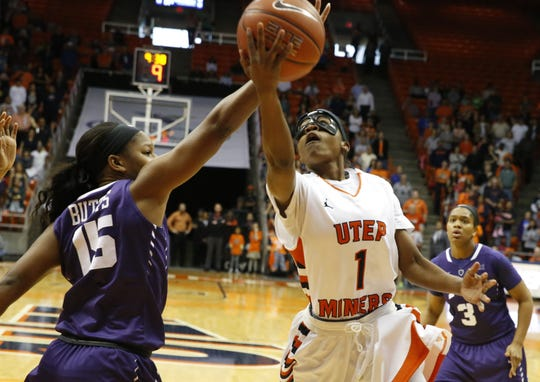 3. UTEP 79, TCU 71, March 24, 2016  UTEP guard Starr Breedlove (right) puts up a shot during first half action against TCU's Jada Butts (left). The Miners pulled away during the second half and walked away with a 79-71 win over TCU.