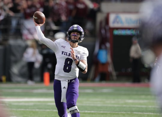 Jake Constantine, shown throwing a pass last November at Montana, threw 33 touchdown passes in two seasons at Weber State.