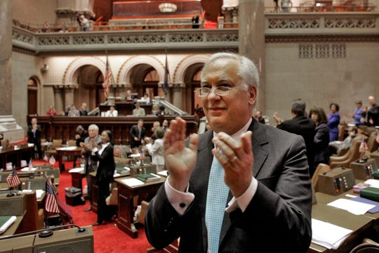FILE — This May 4, 2009 file photo shows Assemblyman Richard Brodsky, D-Elmsford, clapping as the Siena College men's basketball team is introduced in the Assembly Chamber at the Capitol in Albany, N.Y. Brodsky, 73, died Wednesday of suspected complications from the coronavirus. He was known for his work of environmental legislation and overseeing public authorities, as well as his sharp wit and extroverted personality. (AP Photo/Mike Groll, File)