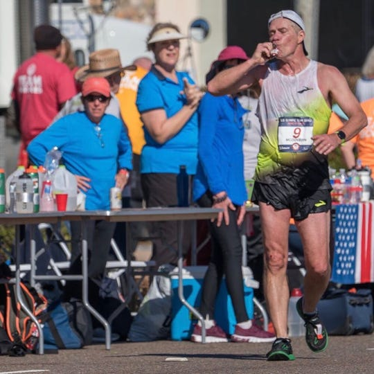 Rockland Track & Field Hall of Fame member Dave McGovern takes a drink while competing in 50K racewalk Olympic Trials in California in  January.