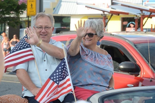 "Roberta ""Bobbie"" Redefer, right, and her husband, the late Dewey Beach Mayor TJ Redefer, ride in the town's Clydesdale Parade."